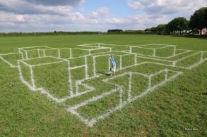 Anamorphosis chalk on grass