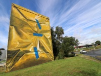 mural-leonkeer-morlaix-wrapped-building-yellow-tape